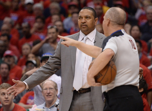 Apr 19, 2014; Los Angeles, CA, USA; Golden State Warriors head coach Mark Jackson talks with referee Ron Garretson (10) in the fourth quarter of game one during the first round of the 2014 NBA Playoffs at Staples Center. Warriors won 109-105. Mandatory Credit: Jayne Kamin-Oncea-USA TODAY Sports