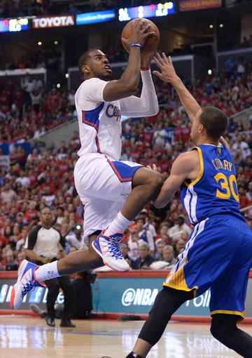 Apr 19, 2014; Los Angeles, CA, USA; Los Angeles Clippers guard Chris Paul (3) shoots over Golden State Warriors guard Stephen Curry (30) in the second half of game one during the first round of the 2014 NBA Playoffs at Staples Center. Warriors won 109-105. Mandatory Credit: Jayne Kamin-Oncea-USA TODAY Sports