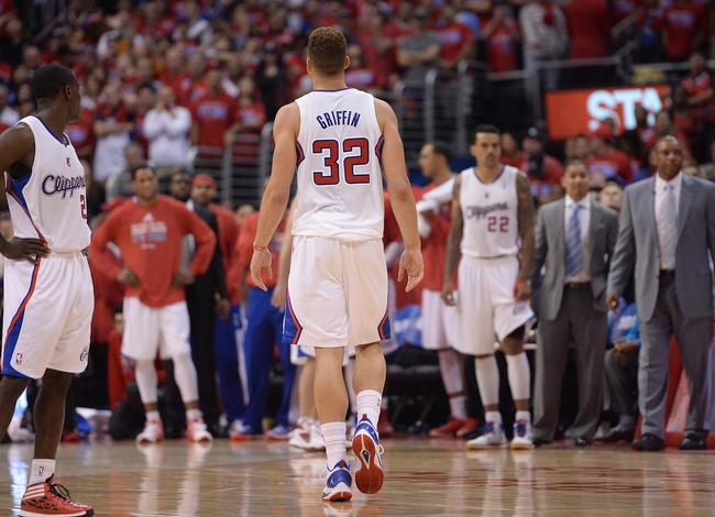 Apr 19, 2014; Los Angeles, CA, USA; Los Angeles Clippers forward Blake Griffin (32) leaves the court after fouling out in the fourth quarter of game one during the first round of the 2014 NBA Playoffs against the Golden State Warriors at Staples Center. Warriors won 109-105. Mandatory Credit: Jayne Kamin-Oncea-USA TODAY Sports