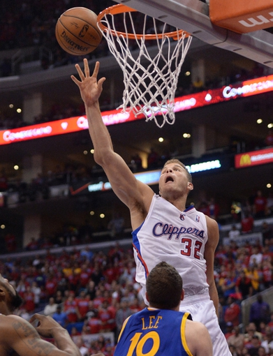 Apr 19, 2014; Los Angeles, CA, USA; Los Angeles Clippers forward Blake Griffin (32) shoots over Golden State Warriors forward David Lee (10) in the second half of game one during the first round of the 2014 NBA Playoffs at Staples Center. Warriors won 109-105. Mandatory Credit: Jayne Kamin-Oncea-USA TODAY Sports