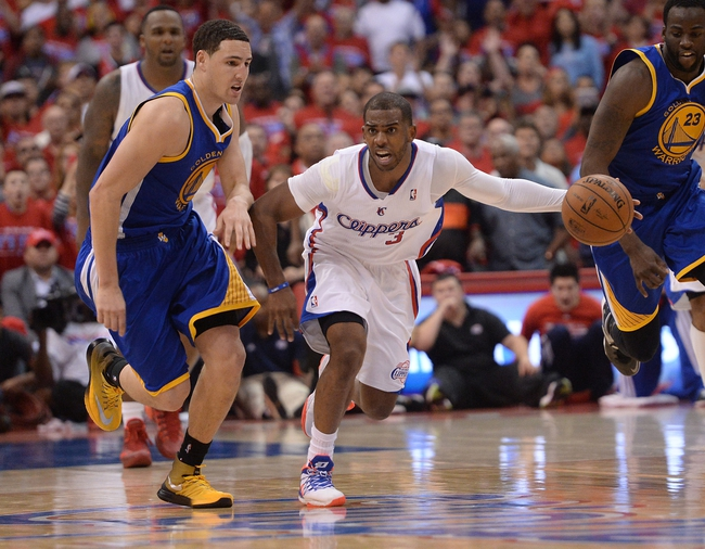 Apr 19, 2014; Los Angeles, CA, USA; Los Angeles Clippers guard Chris Paul (3) steals the ball from Golden State Warriors guard Klay Thompson (11) in the final seconds of game one during the first round of the 2014 NBA Playoffs at Staples Center. Warriors won 109-105. Mandatory Credit: Jayne Kamin-Oncea-USA TODAY Sports
