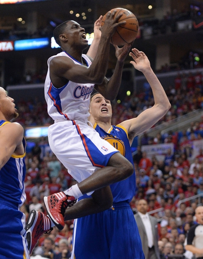 Apr 19, 2014; Los Angeles, CA, USA; Golden State Warriors guard Klay Thompson (11) guard Los Angeles Clippers guard Darren Collison (2) in the second half of game one during the first round of the 2014 NBA Playoffs at Staples Center. Warriors won 109-105. Mandatory Credit: Jayne Kamin-Oncea-USA TODAY Sports