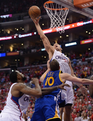 Apr 19, 2014; Los Angeles, CA, USA; Golden State Warriors forward David Lee (10) guards Los Angeles Clippers guard Chris Paul (3) in the second half of game one during the first round of the 2014 NBA Playoffs at Staples Center. Warriors won 109-105. Mandatory Credit: Jayne Kamin-Oncea-USA TODAY Sports