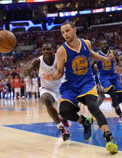 Apr 19, 2014; Los Angeles, CA, USA; Los Angeles Clippers guard Darren Collison (2) and Golden State Warriors guard Stephen Curry (30) chase down the ball in the final seconds of game one during the first round of the 2014 NBA Playoffs at Staples Center. Warriors won 109-105. Mandatory Credit: Jayne Kamin-Oncea-USA TODAY Sports