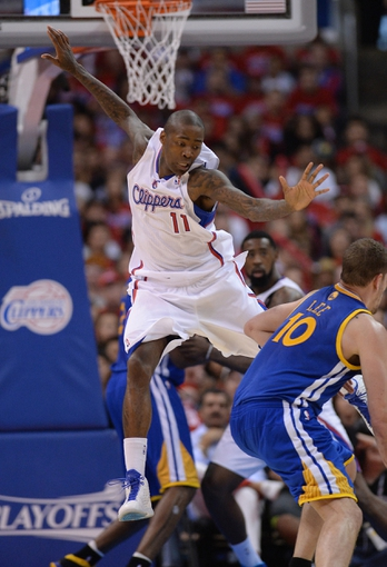 Apr 19, 2014; Los Angeles, CA, USA; Los Angeles Clippers guard Jamal Crawford (11) guards Golden State Warriors forward David Lee (10) in the second half of game one during the first round of the 2014 NBA Playoffs at Staples Center. Warriors won 109-105. Mandatory Credit: Jayne Kamin-Oncea-USA TODAY Sports