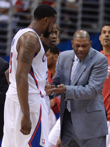 Apr 19, 2014; Los Angeles, CA, USA; Los Angeles Clippers head coach Doc Rivers talks with center DeAndre Jordan (6) in the second half of game one during the first round of the 2014 NBA Playoffs against the Golden State Warriors at Staples Center. Warriors won 109-105. Mandatory Credit: Jayne Kamin-Oncea-USA TODAY Sports