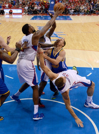 Apr 19, 2014; Los Angeles, CA, USA; Los Angeles Clippers center DeAndre Jordan (6), forward Blake Griffin (32), guard Darren Collison (2) and Golden State Warriors guard Stephen Curry (30) go for a rebound during game one of the first round of the 2014 NBA Playoffs at Staples Center. Warriors won 109-105. Mandatory Credit: Jayne Kamin-Oncea-USA TODAY Sports