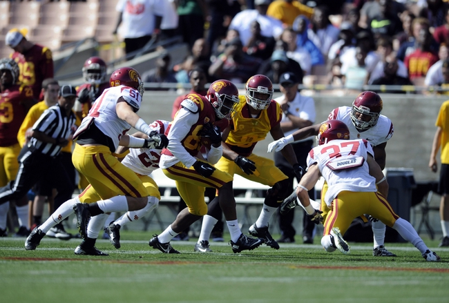 Apr 19, 2014; Los Angeles, CA, USA; Southern California wide receiver Victor Blackwell (center) runs the ball after a catch defended by Southern California inside linebacker Joel Foy (51) and safety Matt Lopes (37)  during the Southern California Spring Game at Los Angeles Memorial Coliseum. Mandatory Credit: Kelvin Kuo-USA TODAY Sports