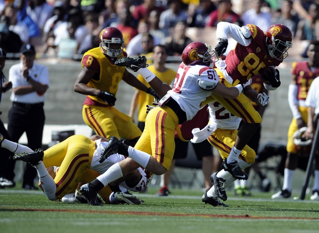 Apr 19, 2014; Los Angeles, CA, USA; Southern California inside linebacker Joel Foy (51) attempts to tackle Southern California wide receiver Victor Blackwell (85) during the Southern California Spring Game at Los Angeles Memorial Coliseum. Mandatory Credit: Kelvin Kuo-USA TODAY Sports