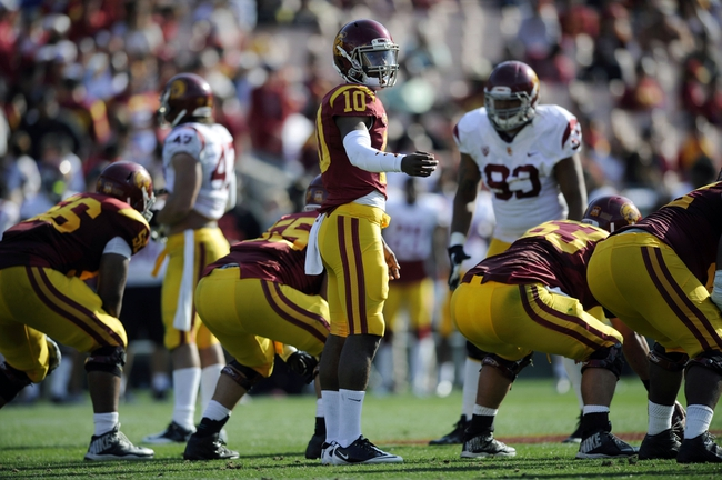 Apr 19, 2014; Los Angeles, CA, USA; Southern California quarterback Jalen Greene (10) looks towards the sidelines for a play call during the Southern California Spring Game at Los Angeles Memorial Coliseum. Mandatory Credit: Kelvin Kuo-USA TODAY Sports