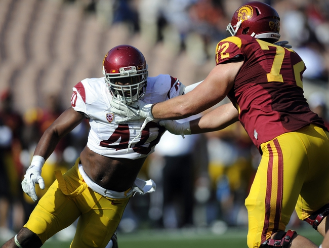 Apr 19, 2014; Los Angeles, CA, USA; Southern California outside linebacker Jabari Ruffin (40) attempts to move around Southern California offensive lineman Chade Wheeler (72) during the Southern California Spring Game at Los Angeles Memorial Coliseum. Mandatory Credit: Kelvin Kuo-USA TODAY Sports