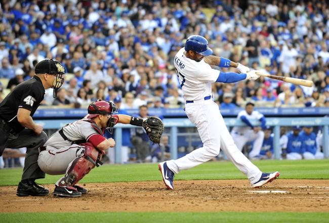 April 19, 2014; Los Angeles, CA, USA; Los Angeles Dodgers center fielder Matt Kemp (27) hits a single in the fourth inning against the Arizona Diamondbacks at Dodger Stadium. Mandatory Credit: Gary Vasquez-USA TODAY Sports