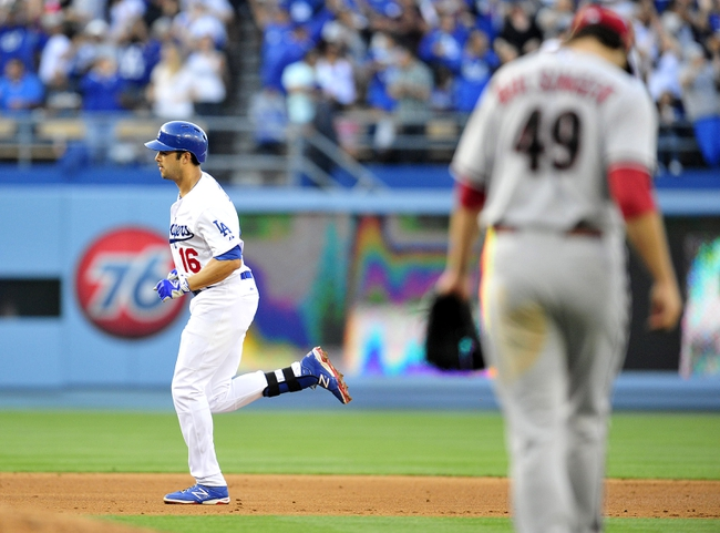 April 19, 2014; Los Angeles, CA, USA; Los Angeles Dodgers center fielder Andre Ethier (16) rounds the bases after hitting a three run home run in the fourth inning against Arizona Diamondbacks starting pitcher Mike Bolsinger (49) at Dodger Stadium. Mandatory Credit: Gary Vasquez-USA TODAY Sports