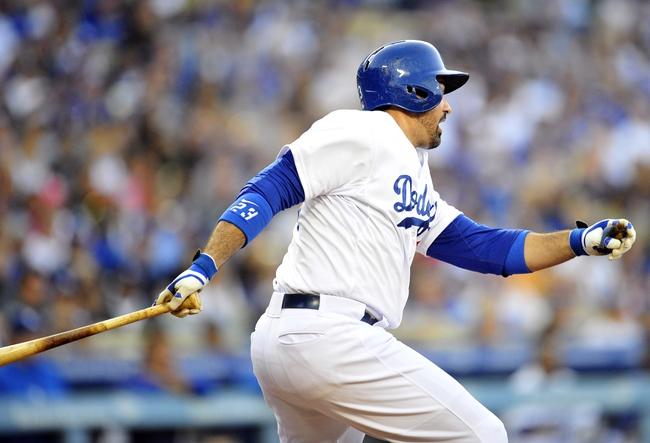 April 19, 2014; Los Angeles, CA, USA; Los Angeles Dodgers first baseman Adrian Gonzalez (23) hits a two run RBI single in the fifth inning against the Arizona Diamondbacks at Dodger Stadium. Mandatory Credit: Gary Vasquez-USA TODAY Sports