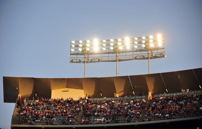 April 19, 2014; Los Angeles, CA, USA; Spectators watch game action between the Los Angeles Dodgers against the Arizona Diamondbacks in the seventh inning at Dodger Stadium. Mandatory Credit: Gary Vasquez-USA TODAY Sports
