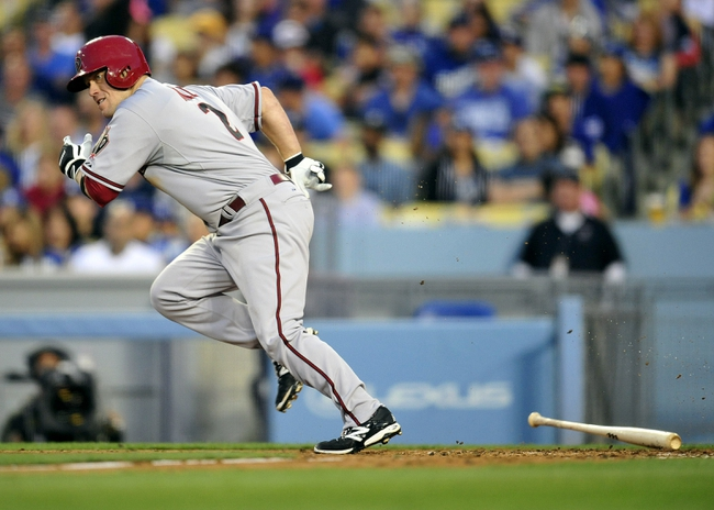 April 19, 2014; Los Angeles, CA, USA; Arizona Diamondbacks second baseman Aaron Hill (2) runs after hitting a single in the eighth inning against the Los Angeles Dodgers at Dodger Stadium. Mandatory Credit: Gary Vasquez-USA TODAY Sports