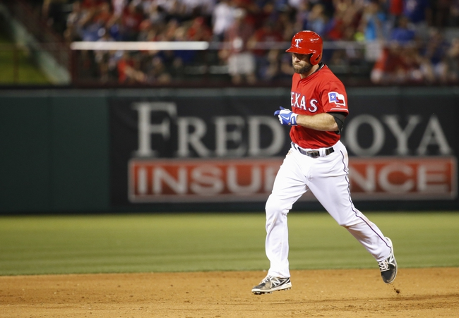 Apr 19, 2014; Arlington, TX, USA; Texas Rangers third baseman Kevin Kouzmanoff (6) rounds the bases after hitting a home run during the eighth inning against the Chicago White Sox at Globe Life Park in Arlington. Texas won 6-3. Mandatory Credit: Kevin Jairaj-USA TODAY Sports