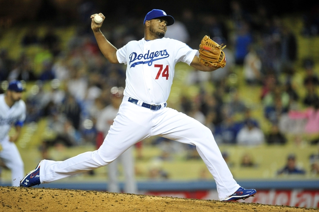 April 19, 2014; Los Angeles, CA, USA; Los Angeles Dodgers relief pitcher Kenley Jansen (74) pitches the ninth inning against the Arizona Diamondbacks at Dodger Stadium. Mandatory Credit: Gary Vasquez-USA TODAY Sports
