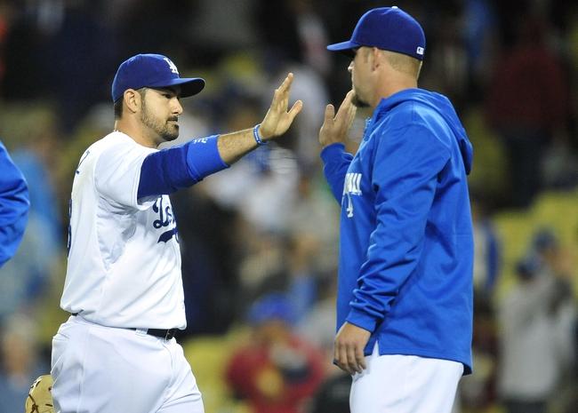 April 19, 2014; Los Angeles, CA, USA; Los Angeles Dodgers first baseman Adrian Gonzalez (23) celebrates the 8-6 victory against the Arizona Diamondbacks at Dodger Stadium. Mandatory Credit: Gary Vasquez-USA TODAY Sports