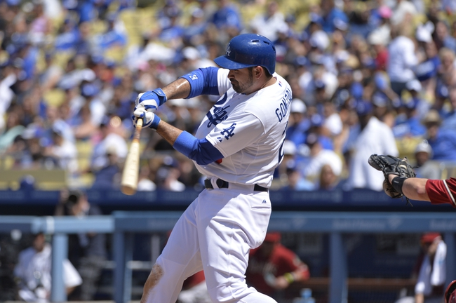 Apr 20, 2014; Los Angeles, CA, USA: Los Angeles Dodgers first baseman Adrian Gonzalez (23) swings the bat during the Dodgers 4-1 win over the Arizona Diamondbacks  at Dodger Stadium. Mandatory Credit: Robert Hanashiro-USA TODAY Sports