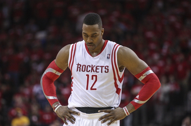 Apr 20, 2014; Houston, TX, USA; Houston Rockets center Dwight Howard (12) walks onto the court during overtime against the Portland Trail Blazers in game one during the first round of the 2014 NBA Playoffs at Toyota Center. The Trail Blazers won 122-120. Mandatory Credit: Troy Taormina-USA TODAY Sports