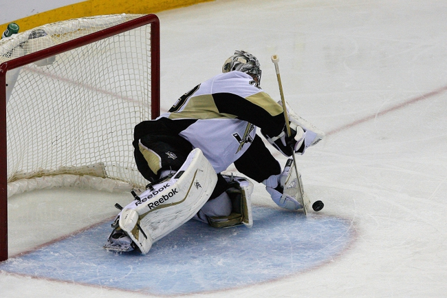 Apr 21, 2014; Columbus, OH, USA; Pittsburgh Penguins center Evgeni Malkin (71) makes a save against the Columbus Blue Jackets during the second period in game three of the first round of the 2014 Stanley Cup Playoffs at Nationwide Arena. Mandatory Credit: Russell LaBounty-USA TODAY Sports