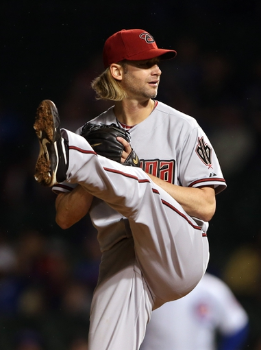 Apr 21, 2014; Chicago, IL, USA; Arizona Diamondbacks starting pitcher Bronson Arroyo throws a pitch against the Chicago Cubs during the first inning at Wrigley Field. Mandatory Credit: Jerry Lai-USA TODAY Sports