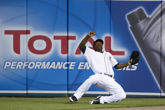 Apr 21, 2014; Detroit, MI, USA; Detroit Tigers right fielder Torii Hunter (48) tries to make a sliding catch in the seventh inning against the Chicago White Sox at Comerica Park. Mandatory Credit: Rick Osentoski-USA TODAY Sports