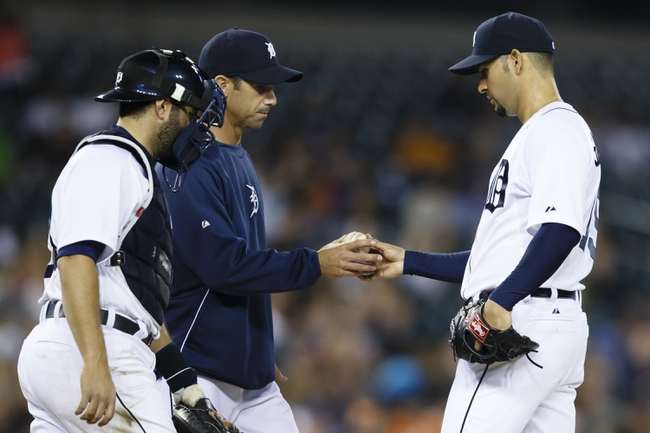 Apr 21, 2014; Detroit, MI, USA; Detroit Tigers manager Brad Ausmus (left) takes the ball to relieve starting pitcher Anibal Sanchez (right) in the seventh inning against the Chicago White Sox at Comerica Park. Mandatory Credit: Rick Osentoski-USA TODAY Sports
