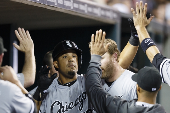 Apr 21, 2014; Detroit, MI, USA; Chicago White Sox first baseman Jose Abreu (79) receives congratulations from teammates after scoring in the seventh inning against the Detroit Tigers at Comerica Park. Mandatory Credit: Rick Osentoski-USA TODAY Sports