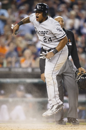 Apr 21, 2014; Detroit, MI, USA; Chicago White Sox right fielder Dayan Viciedo (24) reacts to being called out at home in the seventh inning against the Detroit Tigers at Comerica Park. Mandatory Credit: Rick Osentoski-USA TODAY Sports