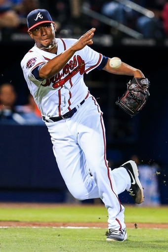 Apr 21, 2014; Atlanta, GA, USA; Atlanta Braves starting pitcher Julio Teheran (49) throws to first for an out in the seventh inning against the Miami Marlins at Turner Field. Mandatory Credit: Daniel Shirey-USA TODAY Sports
