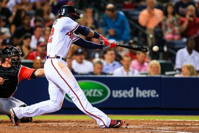 Apr 21, 2014; Atlanta, GA, USA; Atlanta Braves right fielder Jason Heyward (22) hits an RBI single in the seventh inning against the Miami Marlins at Turner Field. Mandatory Credit: Daniel Shirey-USA TODAY Sports