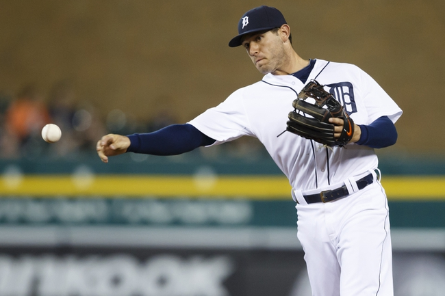 Apr 21, 2014; Detroit, MI, USA; Detroit Tigers second baseman Ian Kinsler (3) makes a throw to first for an out in the eighth inning against the Chicago White Sox at Comerica Park. Mandatory Credit: Rick Osentoski-USA TODAY Sports