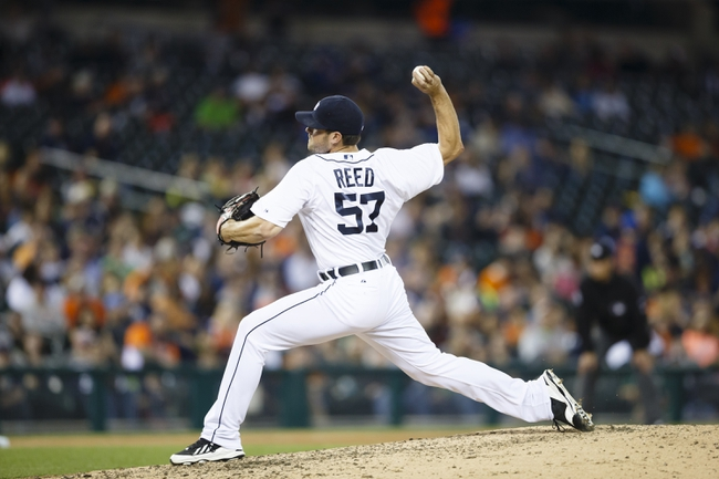 Apr 21, 2014; Detroit, MI, USA; Detroit Tigers relief pitcher Evan Reed (57) pitches in the eighth inning against the Chicago White Sox at Comerica Park. Mandatory Credit: Rick Osentoski-USA TODAY Sports