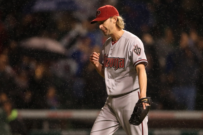 Apr 21, 2014; Chicago, IL, USA; Arizona Diamondbacks starting pitcher Bronson Arroyo reacts after giving up a three-run home run to Chicago Cubs starting pitcher Travis Wood (not pictured) during the second inning at Wrigley Field. Mandatory Credit: Jerry Lai-USA TODAY Sports