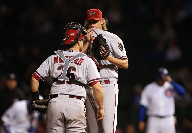 Apr 21, 2014; Chicago, IL, USA; Arizona Diamondbacks starting pitcher Bronson Arroyo (right) talks with catcher Miguel Montero (26) during the second inning against the Chicago Cubs at Wrigley Field. Mandatory Credit: Jerry Lai-USA TODAY Sports