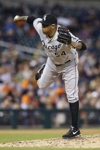 Apr 21, 2014; Detroit, MI, USA; Chicago White Sox relief pitcher Ronald Belisario (54) pitches in the eighth inning against the Detroit Tigers at Comerica Park. Mandatory Credit: Rick Osentoski-USA TODAY Sports