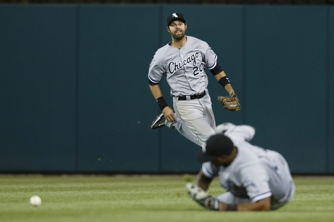 Apr 21, 2014; Detroit, MI, USA; Chicago White Sox right fielder Jordan Danks (20) reacts as right fielder Dayan Viciedo (24) misses the ball hit by Detroit Tigers right atielder Torii Hunter (not pictured) in the eighth inning at Comerica Park. Mandatory Credit: Rick Osentoski-USA TODAY Sports