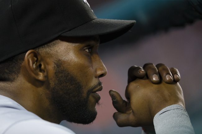Apr 21, 2014; Detroit, MI, USA; Chicago White Sox shortstop Alexei Ramirez (10) watches from the dugout during the sixth inning against the Detroit Tigers at Comerica Park. Mandatory Credit: Rick Osentoski-USA TODAY Sports