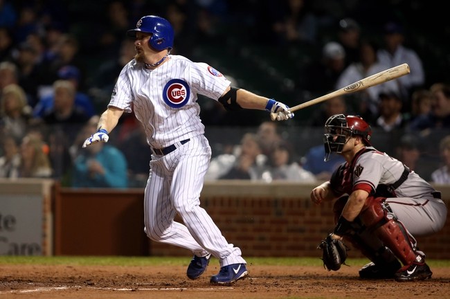 Apr 21, 2014; Chicago, IL, USA; Chicago Cubs starting pitcher Travis Wood hits a RBI double against the Arizona Diamondbacks during the fourth inning at Wrigley Field. Mandatory Credit: Jerry Lai-USA TODAY Sports