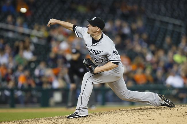 Apr 21, 2014; Detroit, MI, USA; Chicago White Sox relief pitcher Matt Lindstrom (27) pitches in the ninth inning against the Detroit Tigers at Comerica Park. Chicago won 3-1. Mandatory Credit: Rick Osentoski-USA TODAY Sports