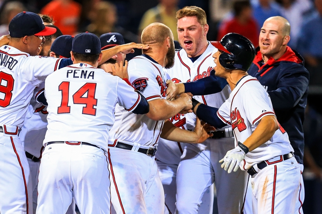 Apr 21, 2014; Atlanta, GA, USA; Atlanta Braves first baseman Freddie Freeman (5) celebrates with catcher Evan Gattis (24) after a walk off two run home run in the tenth inning against the Miami Marlins at Turner Field. Mandatory Credit: Daniel Shirey-USA TODAY Sports