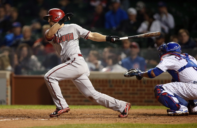 Apr 21, 2014; Chicago, IL, USA; Arizona Diamondbacks shortstop Chris Owings hits a single against the Chicago Cubs during the sixth inning at Wrigley Field. Mandatory Credit: Jerry Lai-USA TODAY Sports