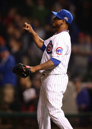 Apr 21, 2014; Chicago, IL, USA; Chicago Cubs relief pitcher Pedro Strop reacts after recording the final out in the game against the Arizona Diamondbacks at Wrigley Field. Mandatory Credit: Jerry Lai-USA TODAY Sports
