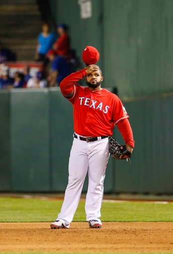 Apr 19, 2014; Arlington, TX, USA; Texas Rangers first baseman Prince Fielder (84) reacts during the game against the Chicago White Sox at Globe Life Park in Arlington. Texas won 6-3. Mandatory Credit: Kevin Jairaj-USA TODAY Sports