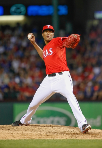 Apr 19, 2014; Arlington, TX, USA; Texas Rangers starting pitcher Alexi Ogando (41) throws during the game against the Chicago White Sox at Globe Life Park in Arlington. Texas won 6-3. Mandatory Credit: Kevin Jairaj-USA TODAY Sports