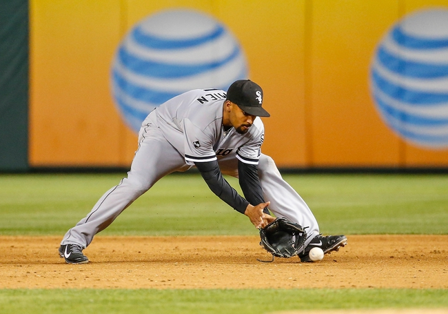 Apr 19, 2014; Arlington, TX, USA; Chicago White Sox second baseman Marcus Semien (5) fields a ground ball during the game against the Texas Rangers at Globe Life Park in Arlington. Texas won 6-3. Mandatory Credit: Kevin Jairaj-USA TODAY Sports