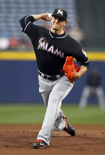 Apr 22, 2014; Atlanta, GA, USA; Miami Marlins starting pitcher Jose Fernandez (16) throws a pitch against the Atlanta Braves in the first inning at Turner Field. Mandatory Credit: Brett Davis-USA TODAY Sports