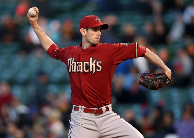 Apr 22, 2014; Chicago, IL, USA; Arizona Diamondbacks starting pitcher Brandon McCarthy throws a pitch against the Chicago Cubs during the first inning at Wrigley Field. Mandatory Credit: Jerry Lai-USA TODAY Sports
